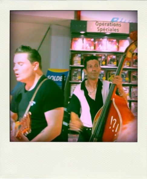 Double-bass player in French music shop