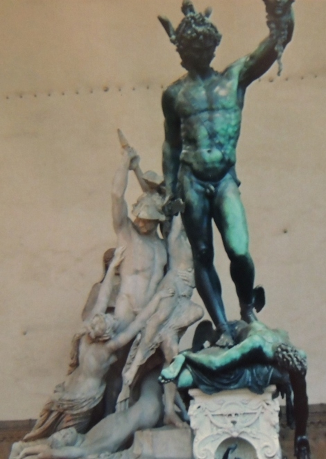 Green and black statue of a man in Florence
