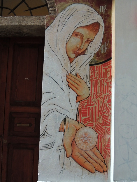 Colourful street mural in Rome - cloaked man with orb