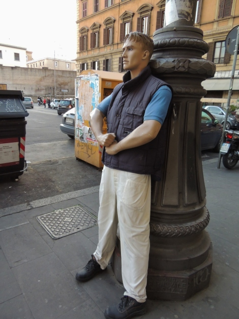 Male mannequin in a city street, Rome