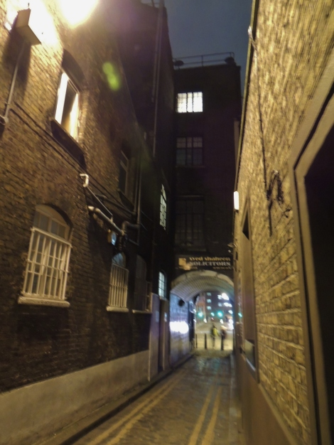 A dark alleyway in Spitalfields, London, by the White Hart pub