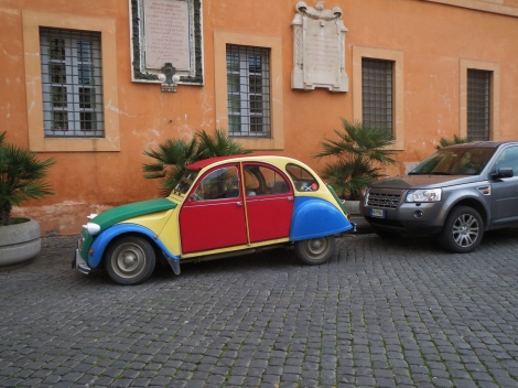 Vintage multicoloured VW Beetle in Trastevere, Rome