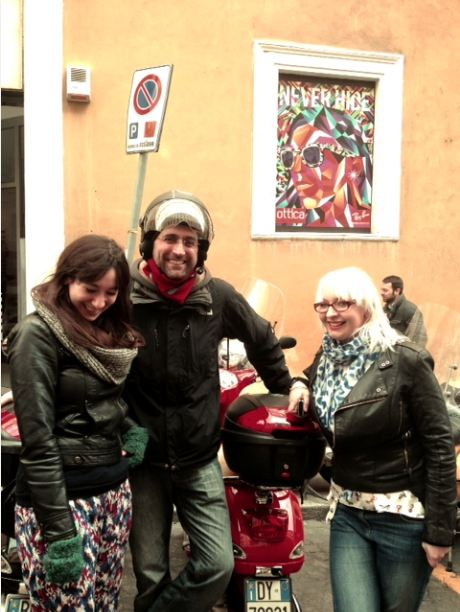 Standing by the Vespa before the tour