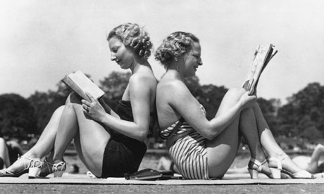 vintage women reading on sunny holiday in swimming costumes