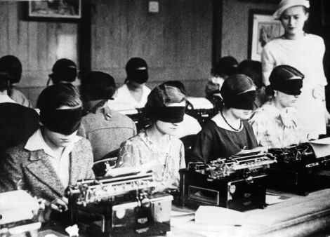 Women typists doing a touch typing test blindfolded