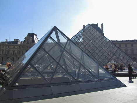 Glass and metal pyramid architecture of the Louvre