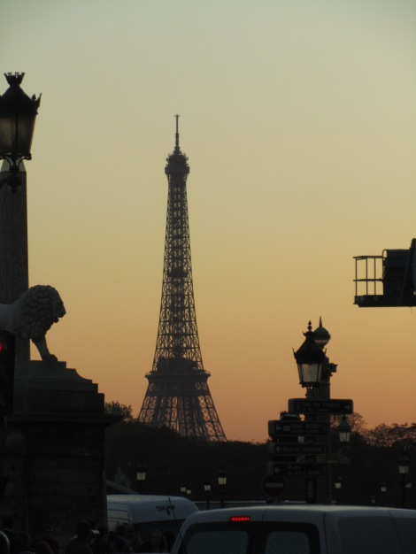 Eiffel Tower at sunset, with street lamp and traffic