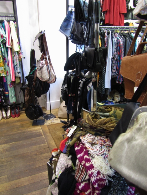 Inside Rue de Temple's Hippy Market, Paris, with clothing rails and vintage bags