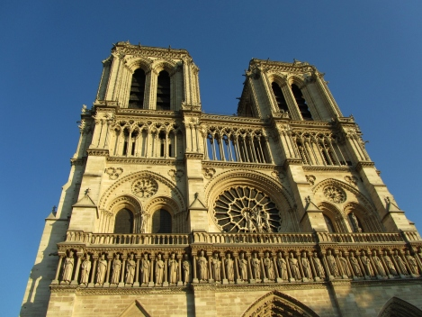The bell towers of Notre Dame against blue sky