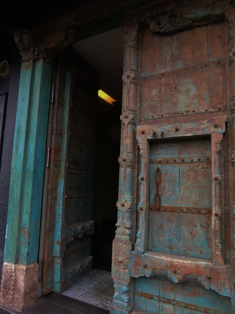 Green and brown elaborate Indian restaurant door