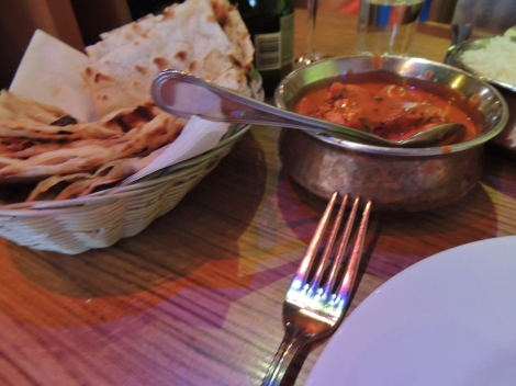 Murg Makhani curry and bread with plate in Reykjavik restaurant