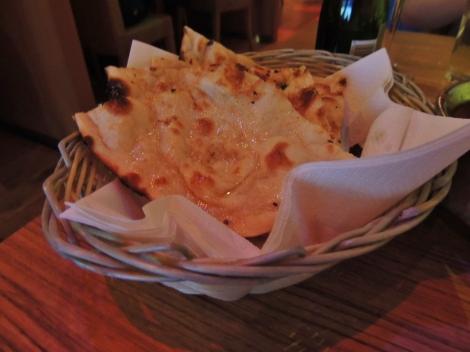 Buttery garlic naan in a basket