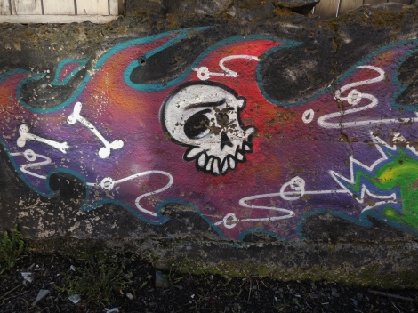 White skull mural on a multi-coloured flame background in Laugavegur