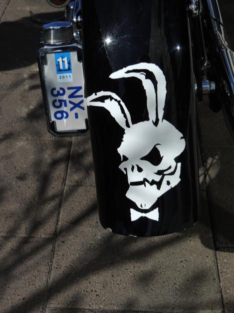 White rabbit skull motif on a black motorbike
