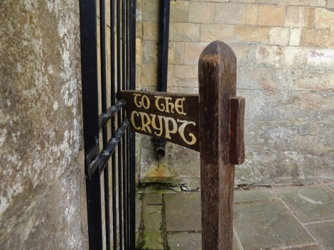 Wooden crypt sign with old fashioned lettering