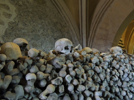Bones and three skulls in the crypt of St. Leonard's