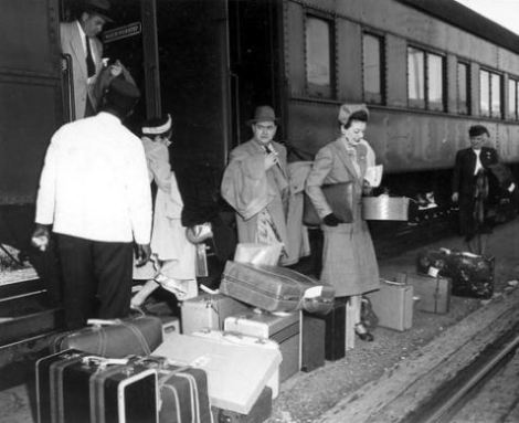 retro luggage being unloaded from a passenger train