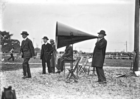 Retro outsize megaphone held by man