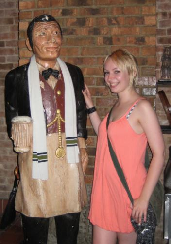 Wooden barman statue in New York pub