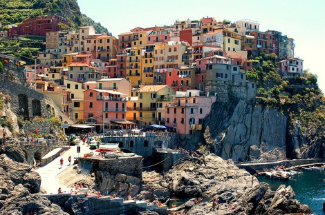 Colourful buildings perched on the rocks in Cinque Terre by Brian Stacey