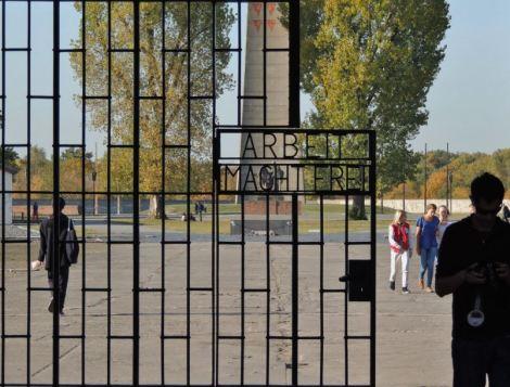 Black metal gates reading 'Arbeit macht frei' at Sachsenhausen