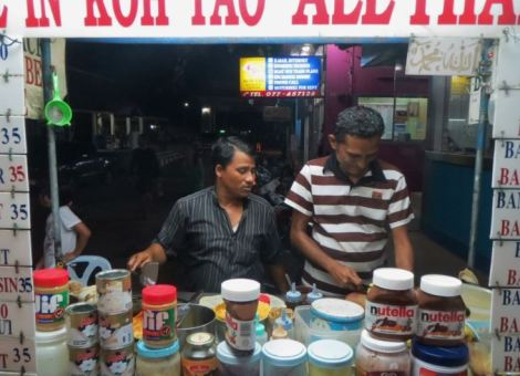 Crepe sellers preparing crepes at night in Koh Tao