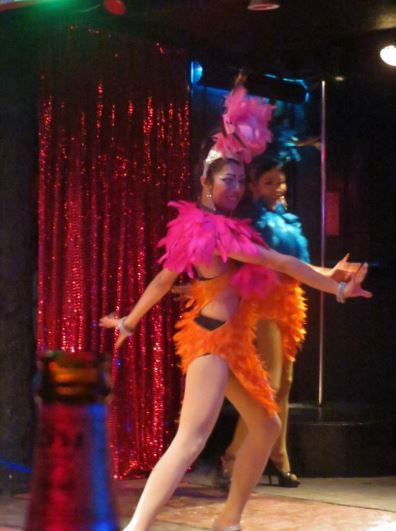 Dancer in feathered colourful costume at Koh Tao cabaret