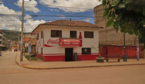 Peru Coca Cola and Claro signs on house